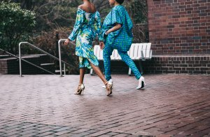 Two African women in their African attire walking on the streets of Accra